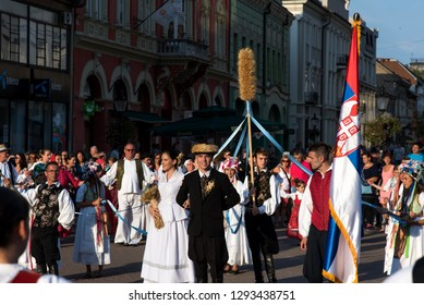 Subotica, Serbia - August 15, 2018: People celebrating harvest season, Duzijance day with a parade in Subotica main square