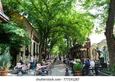 SUBOTICA, SERBIA - CIRCA JULY 2016: Unidentified people sit in outdoor dining areas on a city street