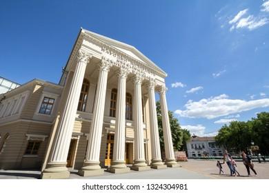 SUBOTICA, SERBIA - JULY 1, 2018: Facade of the National Theater of Subotica, with mention National Theatre translated in Serbian, Croatian & Hungarian.