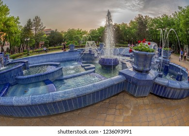 SUBOTICA / VOJVODINA, SERBIA - APRIL 28, 2018: Blue fountain in main square (Trg. Slobode) of the city, in front of the City Hall.