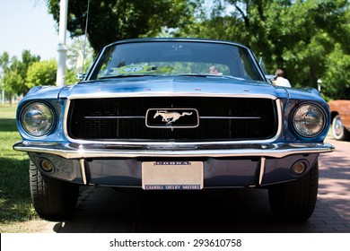 Subotica,Serbia -July 05,2015:Ford Mustang 289 edelbrock on Annual oldtimer car show Subotica 2015.Various vintage cars and motorcycles.In organization of Oldtimer Club.Selective focus on horse badge.