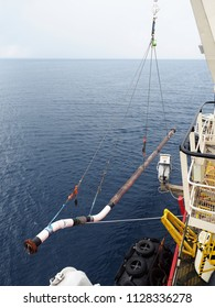 Subsea tie-in spool is lifted alongside dive support vessel that is moving to location.