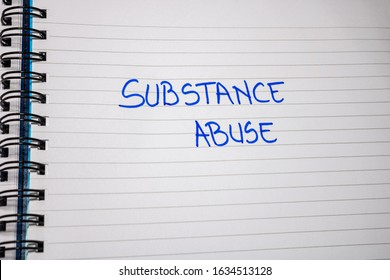 Substance abuse handwriting  text on paper, on office agenda. Copy space.