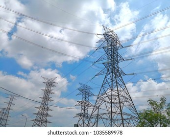 The substation between the electric substation is in the background of the blue sky and the beautiful white clouds