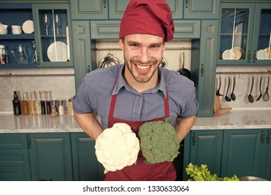 Substitute carefully. Although substitutions seem obvious they can be tricky business. Ruined dish is waste of time. Man chef substitutes broccoli with cauliflower. Chef smiling knows kitchen tricks.