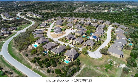Suburb in Dripping Springs , Texas , USA aerial drone view above homes and houses in neighborhood large development in the Central Texas Hill Country large luxury homes with swimming pools
