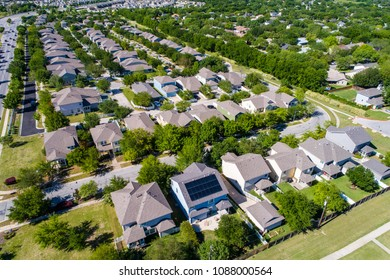 Suburb houses and homes in new real estate development in Austin , Texas , USA aerial drone view solar panel on one rooftop in the suburb neighborhood
