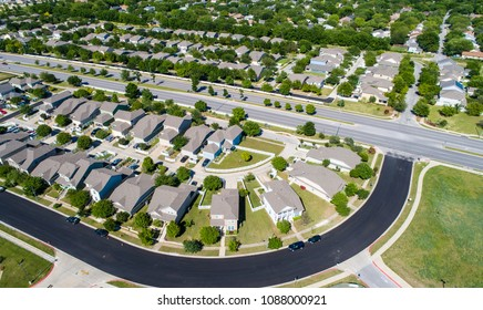 Suburb houses and homes in new real estate development in Round Rock , Texas , USA aerial drone view of curved modern neighborhood in suburb of Austin in Turtle Creek
