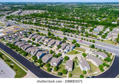 Suburb houses and homes in new real estate development in Austin , Texas , USA aerial drone view huge suburb modern neighborhood in Round Rock , Texas suburb suburbia in Turtle Creek