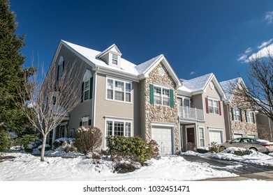 Suburban American townhouse after a recent snowfall.