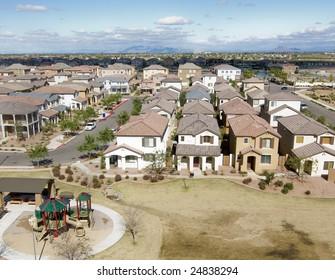 Suburban Arizona community shot from high vantage point looking down onto a housing development