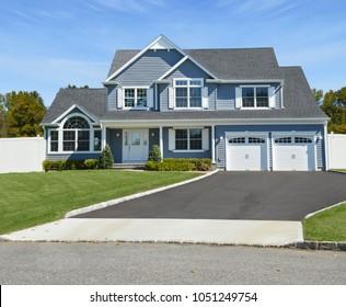 Suburban Blue McMansion two car garage home blue sky USA