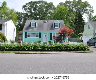 Suburban Cape Cod Bungalow Home in Residential Neighborhood