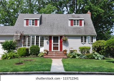 Suburban Cape Cod Style Home Landscaped Front Yard Lawn