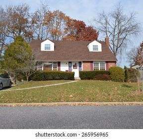 Suburban cape cod style home residential neighborhood USA