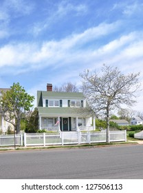 Suburban Cottage Home White Picket Fence American Flag