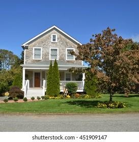 Suburban Gable front House Sunny Residential Neighborhood Clear Blue Sky USA