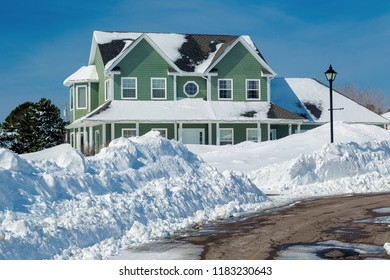 Suburban home after a snow storm.