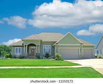 Suburban Home - A beautiful vinyl siding home in the suburbs in Michigan, USA in summer time.