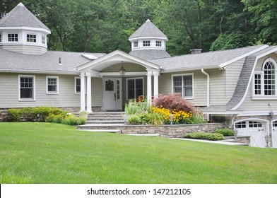 Suburban home with Black Eyed Susan Flowers Japanese Maple Tree