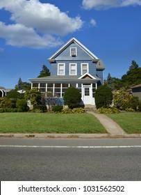 Suburban home blue sky clouds USA