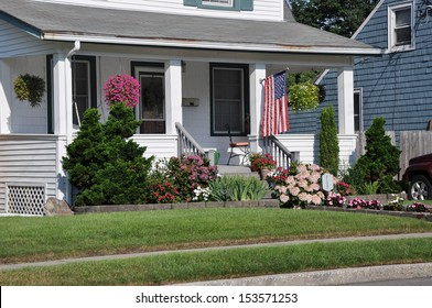 Suburban Home Porch Front yard American Flag Flowers