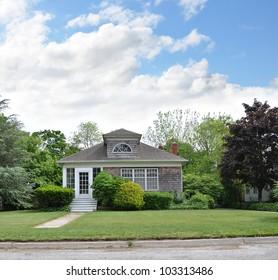 Suburban Home residential neighborhood cloudy blue sky