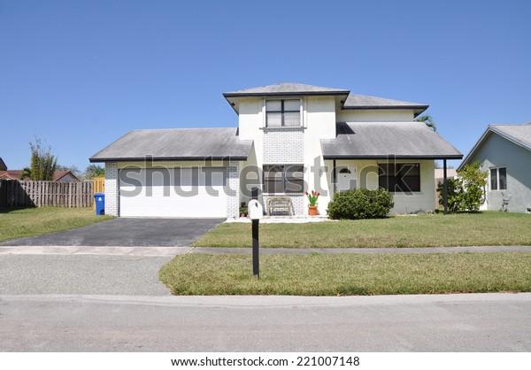 Suburban home residential neighborhood USA clear blue sky
