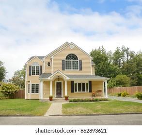Suburban McMansion Home blue sky clouds USA