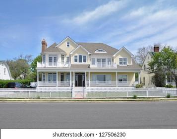 Suburban McMansion Yellow House Sunny Day