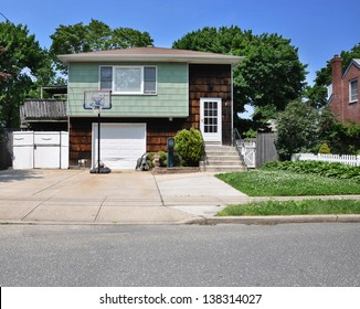 Suburban Middle Class Home in Residential Neighborhood Basketball Hoop in Driveway