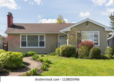 Suburban Middle-Class House with Front Lawn