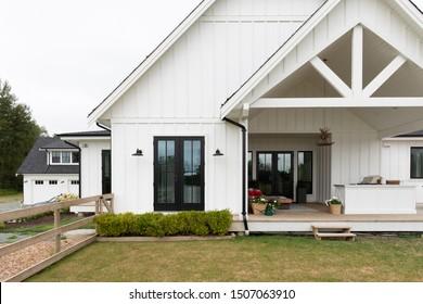 Suburban modern luxury farmhouse on an overcast day