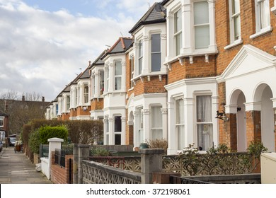 Suburban Neighborhood Houses in a winter sunny day in West London, United Kingdom.