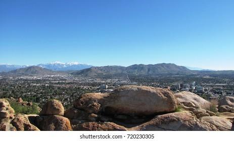 Suburban neighborhoods viewed from a rocky hill side, California