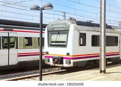 Suburban railway train at the railways stantion .