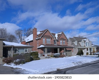 Suburban Residential neighborhood with single family houses with large front yards on a sunny day in winter
