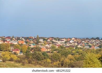 Suburban skyline. Buildings individual suburban housing in the green plants district. Dubovskoye rural settlement, Belgorod Region, Russia.