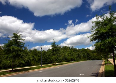 a suburban street with beautiful clouds in the sky