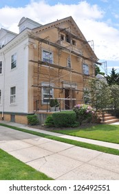 Suburban Three Story Home with Scaffolding