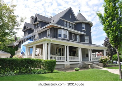 Suburban Three story tall Queen Anne style Victorian Home under Repair Remodeling