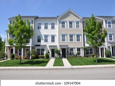 Suburban Three story Town Homes Sunny Blue Sky Day