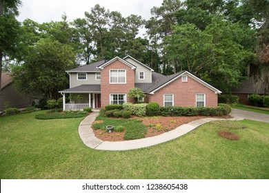Suburban two-story house with garage and sidewalk