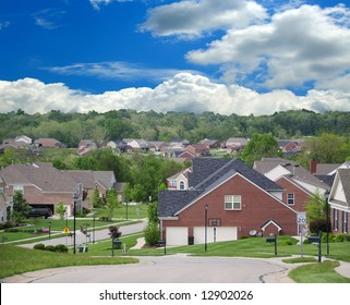 The Suburbs - A Community of Brick Suburban Homes on a cloudy summer day.