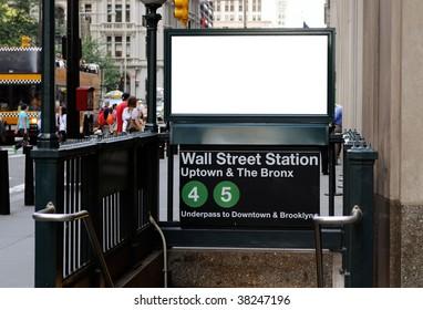 Subway ad in Wall Street Station. Blank billboard, crowds, New York City