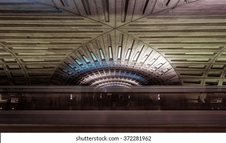 Subway blur and dramatic vaulted ceiling of the Washington DC metro station