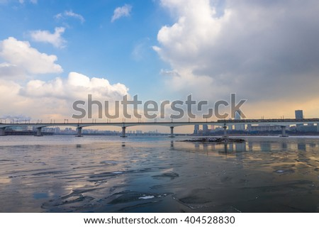 Subway bridge over Han river covered with ice in winter, Seoul, South Korea