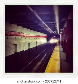 Subway car arriving underground in the New York City subway station with Instagram effect filter.