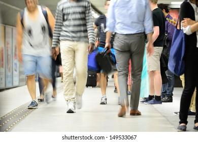 Subway passengers walking on platform