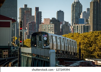 A Subway Train Approaching an Above Ground Station in New York